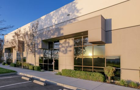 Exterior photo at sunset of Altamont Business Centre, a 151,139 SF office located in a beautiful park-like setting only minutes from I-580.
