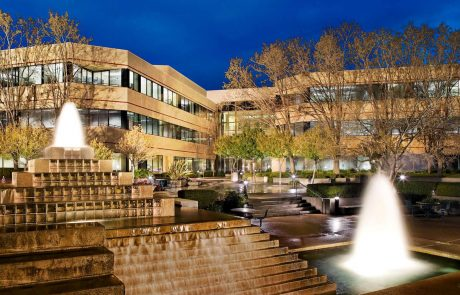 Exterior photo showing architecture and fountain at dusk at Hacienda West, a 208,883 SF Class A office project located in the prestigious Hacienda Business Park in Pleasanton, CA
